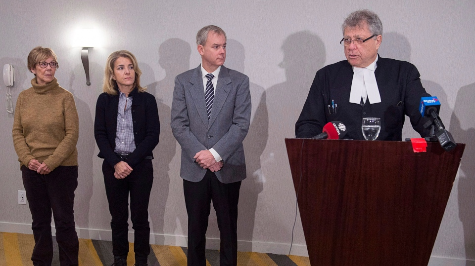 Dennis Oland, his wife Lisa and his mother Connie Oland, left, attend a news briefing held by their lawyer Alan Gold, right, in Saint John, N.B., on Tuesday, Nov. 20, 2018. (THE CANADIAN PRESS/Andrew Vaughan)