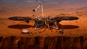 This illustration made available by NASA in 2018 shows the InSight lander drilling into the surface of Mars. (NASA via AP)