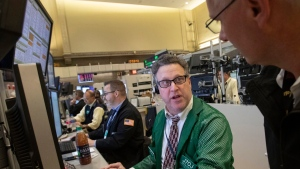 Martin Handler, center, works with S&P 500 options, Tuesday, Nov. 20, 2018, at the New York Stock Exchange. (AP Photo/Mark Lennihan)