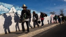 Central American migrants who are part of a Central American migrant caravan leave Mexicali for Tijuana, Mexico, Tuesday, Nov. 20, 2018. (AP / Rodrigo Abd)