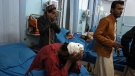 Injured men receive treatment at a hospital after a suicide bombing in Kabul, Afghanistan, Nov. 20, 2018. (AP / Rahmat Gul)