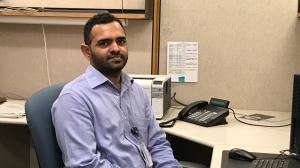 Iqbal Singh Sharma works in his new position at SaskTel (Joey Slattery / CTV Regina)