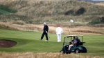 In this Saturday, July 14, 2018, file photo, U.S. President Donald Trump walks off the 4th green while playing at Turnberry golf club, in Turnberry, Scotland. (AP Photo/Peter Morrison)