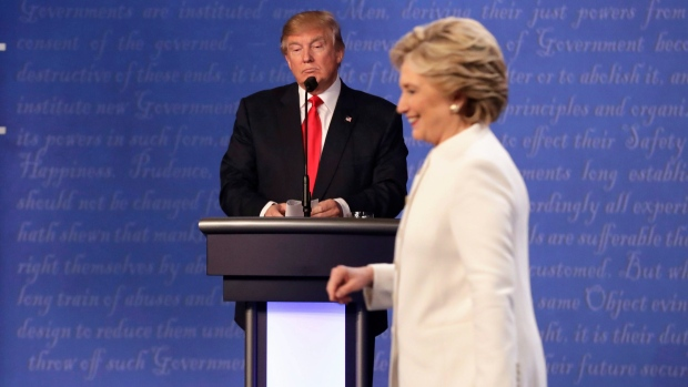 In this file photo, Republican presidential nominee Donald Trump waits behind his podium as Democratic presidential nominee Hillary Clinton makes her way off the stage following the third presidential debate at UNLV in Las Vegas, Wednesday, Oct. 19, 2016. (AP Photo/David Goldman)