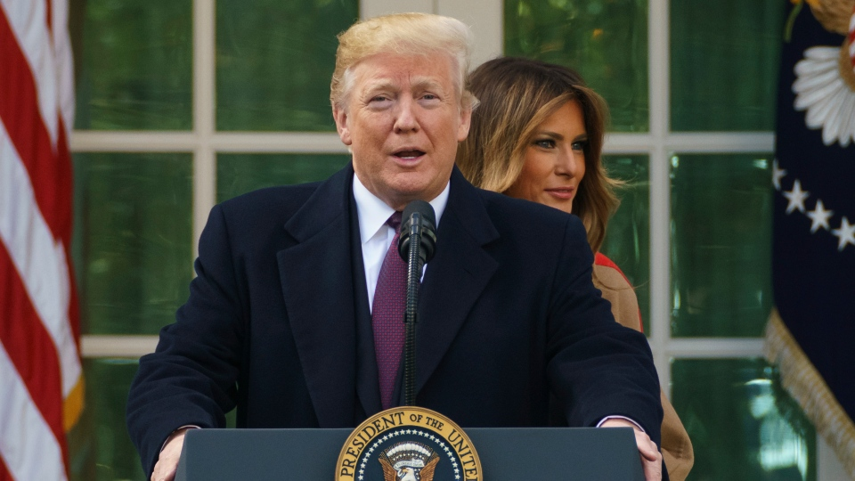 President Donald Trump and first lady Melania Trump arrive for a ceremony to pardon the National Thanksgiving Turkey in the Rose Garden of the White House in Washington, Tuesday, Nov. 20, 2018. (AP Photo/Carolyn Kaster)