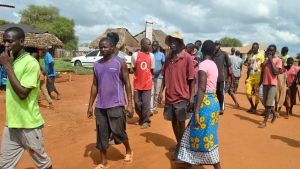 Villagers gather on the streets in the village of Chakama, where gunmen kidnapped an Italian volunteer, in coastal Kilifi county, Kenya Wednesday, Nov. 21, 2018.(AP Photo)