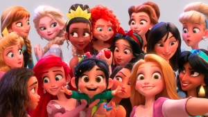 The character Vanellope von Schweetz, voiced by Sarah Silverman, foreground centre, posing for a selfie with Disney princesses in a scene from 'Ralph Breaks the Internet.' (Disney via AP)