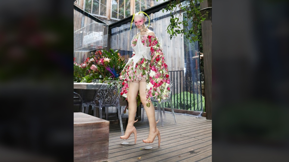 Hannah Rose Dalton modelled the skin heels while wearing a dress made of real flowers at Fecal Matter's first fashion show in London in October. (Fecal Matter)