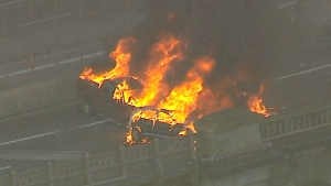 A fatal car fire on the Brooklyn Bridge in New York.