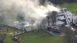 Four people dead after mansion goes up in flames
