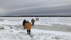 Mounties and fire services from Sagkeeng First Nation and Pine Falls were involved, and a set of snowmobile tracks were spotted leaving the south shore, leading to open water. (File image).