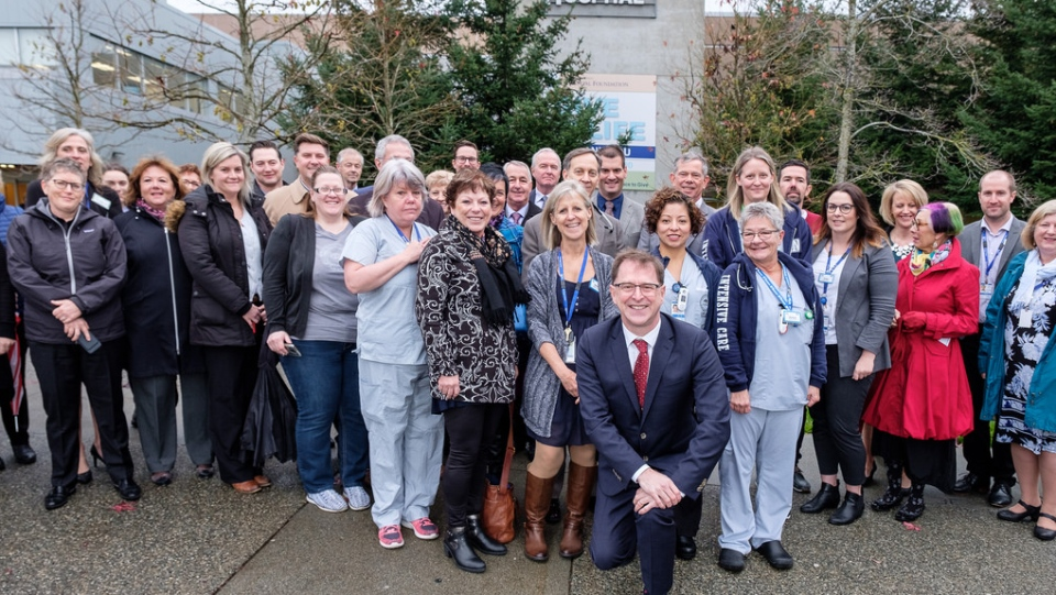 Health Minister Adrian Dix poses with staff at Nanaimo Regional General Hospital after the province announced it would fund a new intensive care unit. Nov. 21, 2018. (Flickr)