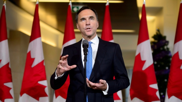 Finance Minister Bill Morneau holds a press conference in the media lockup for the fall economic update, in Ottawa on Wednesday, Nov. 21, 2018. (THE CANADIAN PRESS/Sean Kilpatrick)