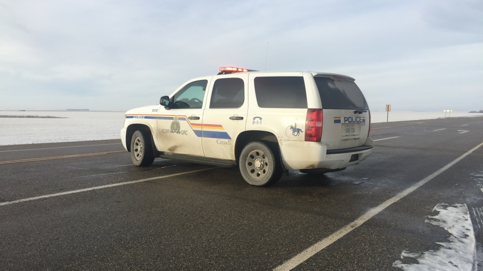 RCMP close off Highway 4, north of Rosetown, Sask., as they investigate a firefighter's death. (Laura Woodward/CTV News)