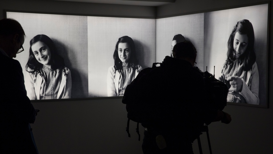 Journalists take images of the renovated Anne Frank House Museum in Amsterdam, Netherlands, Wednesday, Nov. 21, 2018. The museum is built around the secret annex hidden in an Amsterdam canal-side house where teenage Jewish diarist Anne Frank hid from Nazi occupiers during World War II is expanding to better tell Anne's tragic story to the growing number of visitors. (AP Photo/Peter Dejong)