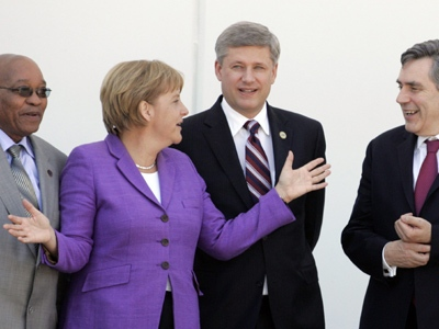 From left, South Africa's President Jacob Zuma, German Chancellor Angela Merkel, Prime Minister Stephen Harper, and British Prime Minister Gordon Brown share a word in L'Aquila, Italy on Friday, July 10, 2009. (AP / Michel Euler)