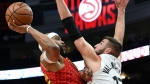 Atlanta Hawks forward Vince Carter shoots over Toronto Raptors center Jonas Valanciunas during the first half of an NBA basketball game Wednesday, Nov. 21, 2018, in Atlanta. (AP Photo/John Amis)