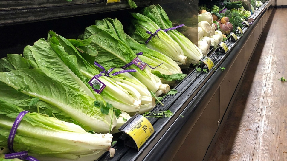 Romaine Lettuce still sits on the shelves as a shopper walks through the produce area of an Albertsons market Tuesday, Nov. 20, 2018, in Simi Valley, Calif. (AP / Mark J. Terrill)