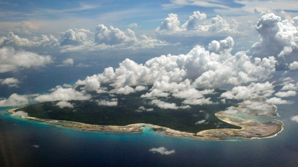 In this Nov. 14, 2005 file photo, clouds hang over the North Sentinel Island, in India's southeastern Andaman and Nicobar Islands. (AP Photo/Gautam Singh, File)