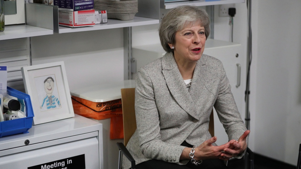 Britain's Prime Minister Theresa May visits a health centre in north London, Thursday Nov. 22, 2018. (Andrew Matthews/Pool via AP)