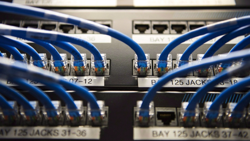 Canadian banks are combating cyberattackers by hiring their own in-house ethical hackers and investing in cybersecurity research. Networking cables on a batch board are shown in Toronto on Wednesday, Nov. 8, 2017. (THE CANADIAN PRESS/Nathan Denette)