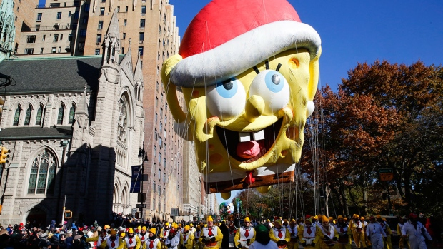 A Spongebob Squarepants balloon floats over Central Park West during the 92nd annual Macy's Thanksgiving Day Parade in New York, Thursday, Nov. 22, 2018. (AP Photo/Eduardo Munoz Alvarez)