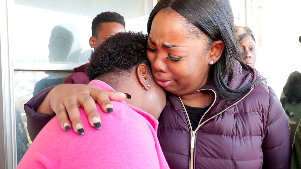 In this Tuesday, Nov. 20, 2018 photo, Bernice Parks, left, is consoled by Jasmine Wells, center, Sandra Parks's godmother, after Bernice Parks talked about her daughter, 13-year-old Sandra Parks. (Mike De Sisti/Milwaukee Journal-Sentinel via AP)