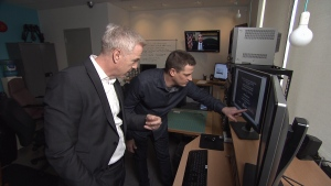 David McKay of BCIT's Forensic Science & Technology School of Computing and Academic Studies identifies fake document.