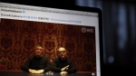 """Founders of Dolce&Gabbana Domenico Dolce, left, and Stefano Gabbana apologize in a video on Chinese social media, saying """"sorry"""" in Mandarin seen on a computer screen in Beijing, China, Friday, Nov. 23, 2018. The Italian fashion house has been in hot water for controversial video ads and insulting remarks on China made by Instagram accounts of its co-founder. (AP Photo/Ng Han Guan)"""