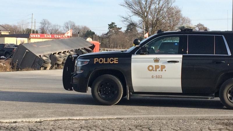 OPP investigate a fatal collision involving a transport truck on Richmond Street and Denfield Road on Friday, Nov. 23, 2018. (Joel Merritt / CTV London)