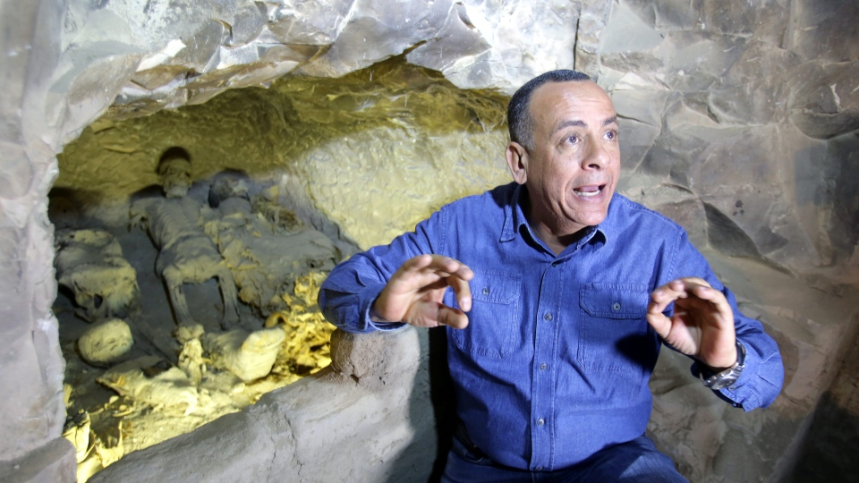 Mostafa Waziri, Secretary General of the Supreme Council of Antiquities, speaks inside the newly discovered tomb at al-Assassif Necropolis, in Luxor, 700km south of Cairo, Egypt, 24 November 2018. EPA/KHALED ELFIQI