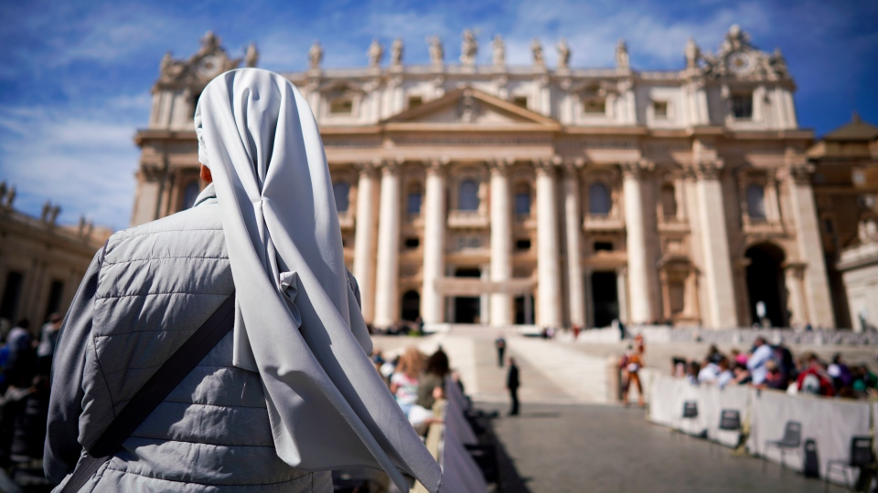 In this Wednesday, Sept. 26, 2018 file photo, a nun waits for the arrival of Pope Francis for his weekly general audience, in St. Peter's Square at the Vatican. (AP Photo/Andrew Medichini)