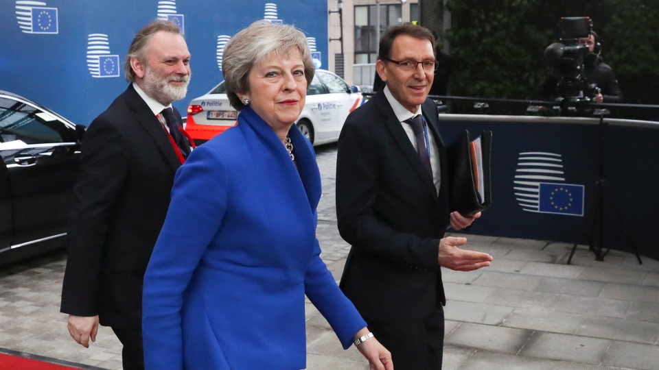 British Prime Minister Theresa May arrives for an EU summit at the Europa building in Brussels, Sunday, Nov. 25, 2018. (Yves Herman, Pool Photo via AP)