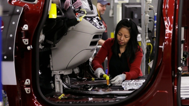 Tina Nguyen works on a Chrysler in Windsor