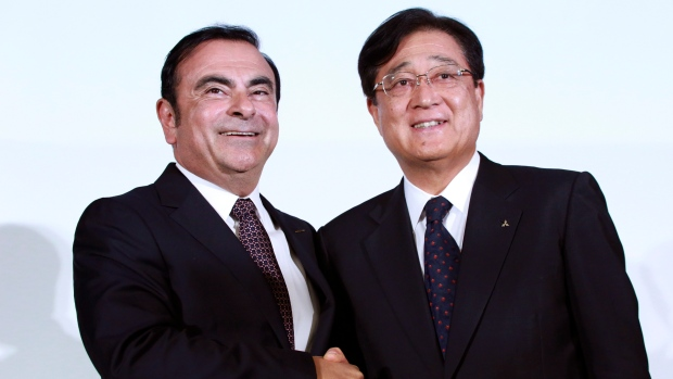 Nissan's ex-chair Ghosn wants separate trial from automaker