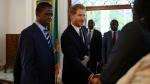 Prince Harry is flanked by Zambia's President Edgar Lungu during his visit at State House in Lusaka, Monday, Nov. 26, 2018. (AP Photo/Tsvangirayi Mukwazhi)