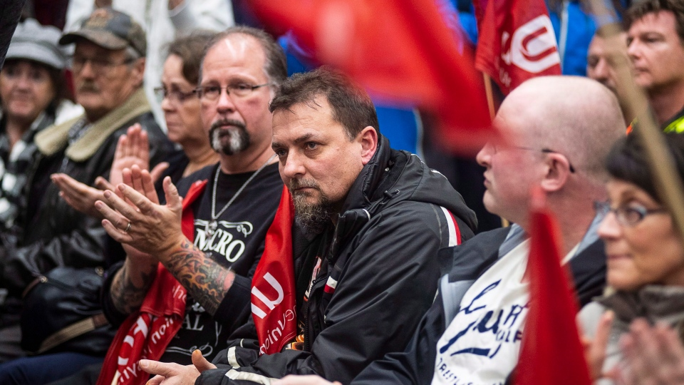 Workers of Oshawa's General Motors car assembly plant, listen to Jerry Dias, president of UNIFOR, the union representing the workers, at the union headquarters in Oshawa, Ont. on Monday, Nov. 26, 2018. (THE CANADIAN PRESS/Eduardo Lima)