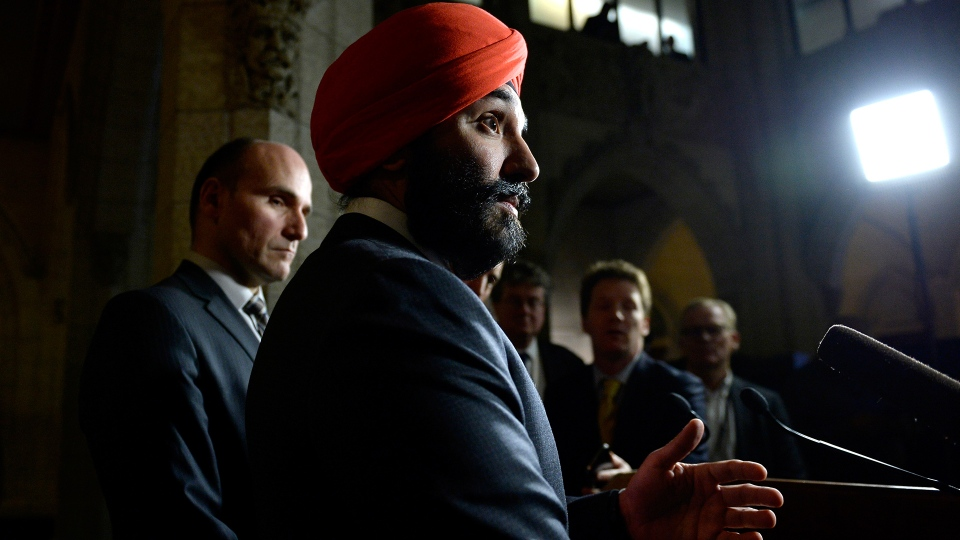 Minister of Innovation, Science and Economic Development Navdeep Bains speak as Minister of Families, Children and Social Development Jean-Yves Duclos, left, listens during a press conference on General Motors' decision regarding the future of its automotive plant in Oshawa, on Parliament Hill in Ottawa on Monday, Nov. 26, 2018. (THE CANADIAN PRESS/Justin Tang)