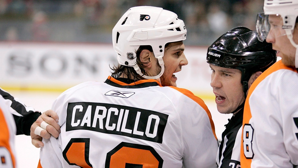 Philadelphia Flyers left wing Daniel Carcillo is restrained by referee Ian Walsh (29) in the first period against the Minnesota Wild during a preseason NHL hockey game in St. Paul, Minn., on September 25, 2010. (THE CANADIAN PRESS/AP, Andy King)