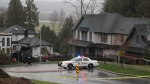 A Surrey neighbourhood is seen cordoned off with police tape on Nov. 26, 2018 following a fatal shooting.