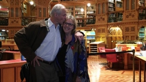John Kidder kisses his new fiance, Green Party Leader Elizabeth May, in the Library of Parliament. (Green Party of Canada / Twitter)