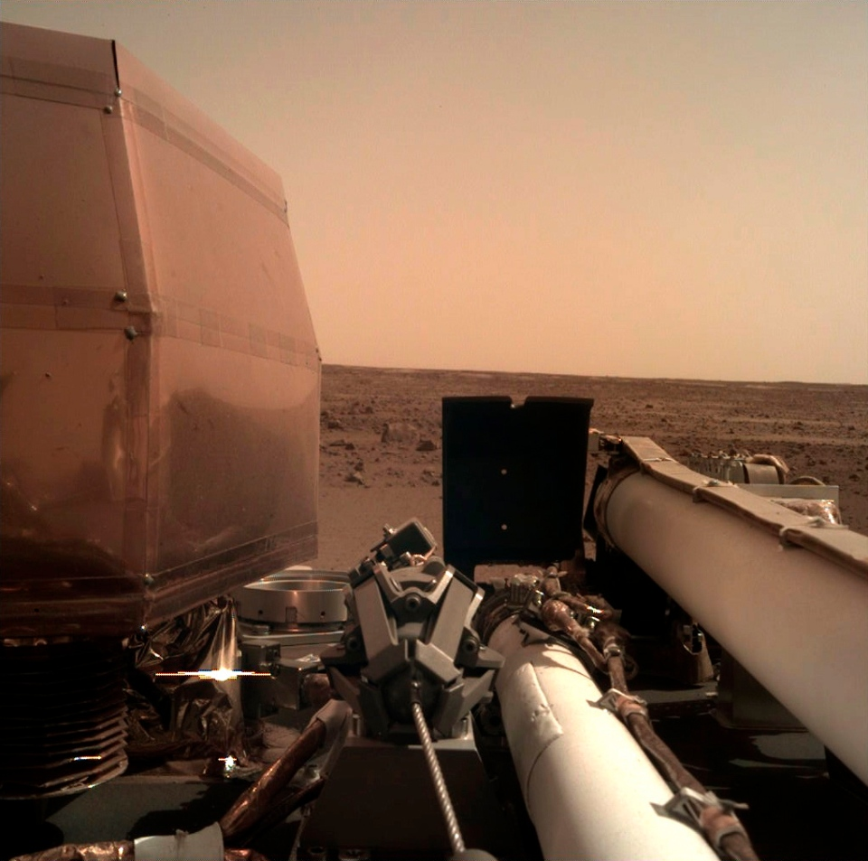 This photo provided by NASA shows an image on Mars that its spacecraft called InSight acquired using its robotic arm-mounted, Instrument Deployment Camera (IDC) after it landed on the planet on Monday, Nov. 26, 2018. (NASA via AP)