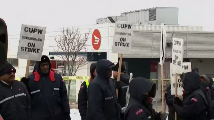 Canada Post workers forced to end strike due to federal legislation.