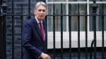 Britain's Chancellor Philip Hammond walks past 10 Downing Street in London, Thursday, Nov. 22, 2018. (AP Photo/Kirsty Wigglesworth)