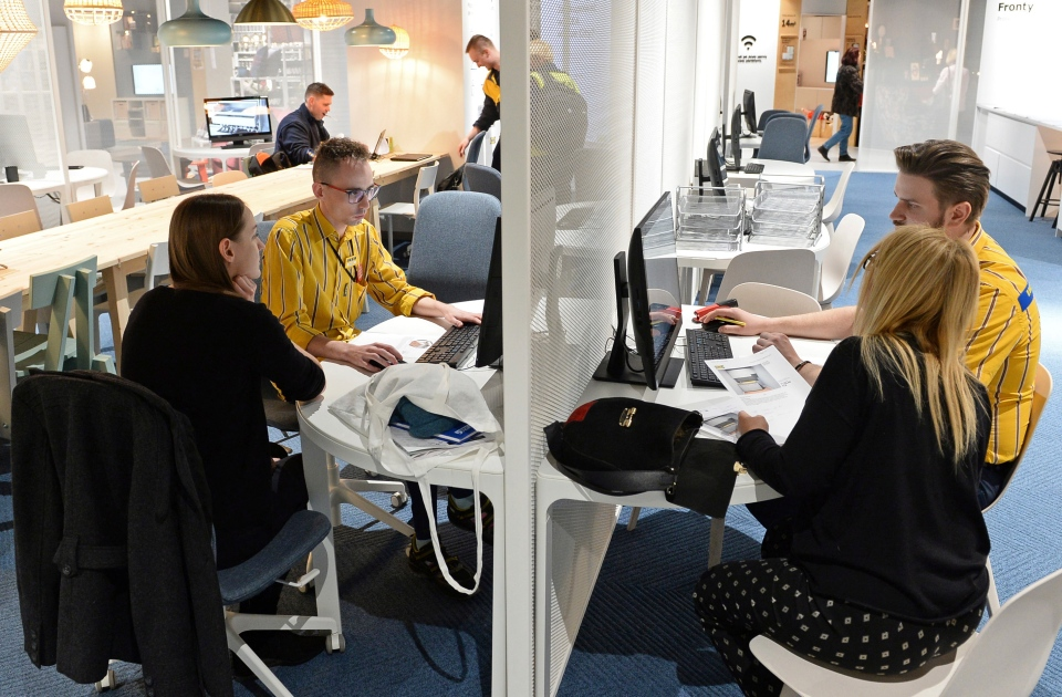 In this Thursday Nov. 22, 2018 photo, Ikea advisors help customers to arrange their interiors, at a new Ikea store, in Warsaw, Poland. (AP Photo/Alik Keplicz)