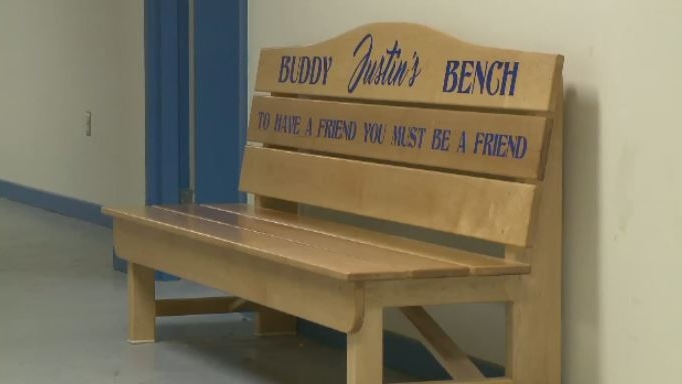 "This ""buddy bench"" in memory of Justin Newell is meant to help students at Sydney Academy feel comfortable, and not alone, when facing daily struggles."