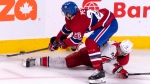 Montreal Canadiens' Jeff Petry works over Carolina Hurricanes' Warren Foegele to get the puck during third period NHL hockey action in Montreal on Tuesday, November 27, 2018. THE CANADIAN PRESS/Paul Chiasson