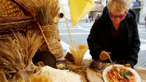 A woman enjoys spaghetti with traditional tomato and basil sauce during an event staged by the Italian Coldiretti (Farmers organization) at the Campidoglio, Capitol Hill square, in Rome, Tuesday, Nov. 16, 2010. (AP Photo/Riccardo De Luca)