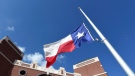 In this file photo, the Texas flag is seen in Santa Fe, Texas on Tuesday, May 22, 2018. (AP Photo/Jeffrey McWhorter)