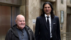"James Sears, right, editor in chief of ""Your Ward News,"" and publisher LeRoy St. Germaine, is seen outside Ontario court in Toronto on Wednesday, Nov. 28, 2018. Sears is charged with willfully promoting hatred of women and Jews. THE CANADIAN PRESS/Colin Perkel"